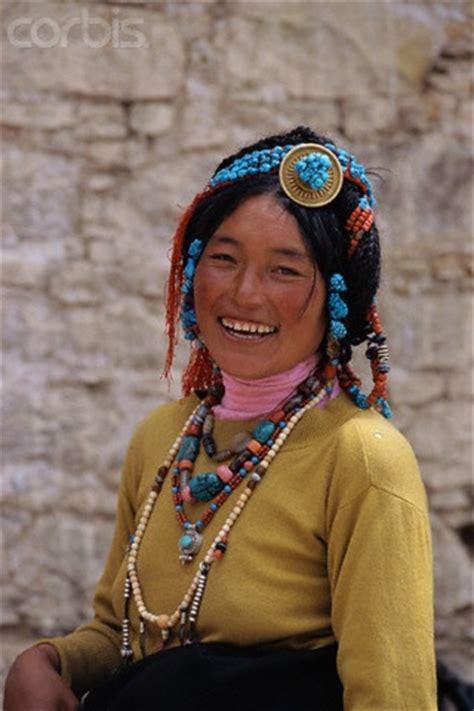 smiling tibetan woman wearing traditional jewellery lhasa