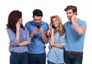 Man Texting While Friends Are Talking On Phone Stock Photo ...