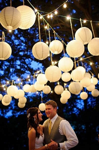 hanging paper lanterns outdoor how lighting can affect your wedding