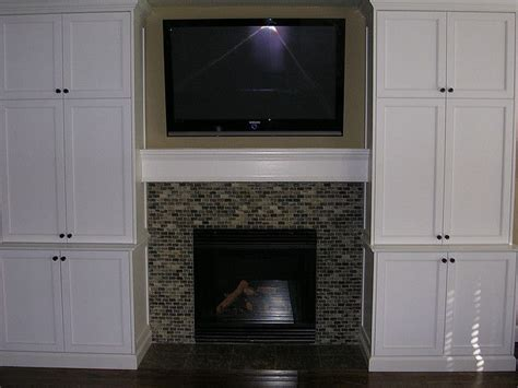 turn tv into fireplace turn the built in shelves into cabinets like these tv