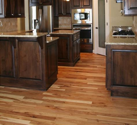 dark cabinets with hickory wood floors wood floors