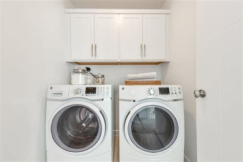 cabinets over washer and dryer laundry room cabinets above washer and dryer imanisr com