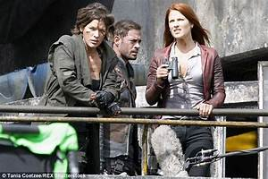 Milla Jovovich is bloody and bruised as she and Ali Larter ...