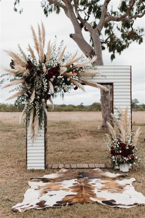 iron wedding arch  plumes  pampas grass  burgundy