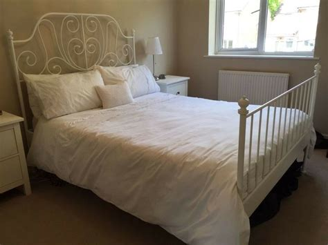 ikea white metal bed frame with mattress in