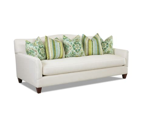 bench couch sofa contemporary stationary sofa with bench seat cushion and camel back by klaussner wolf and
