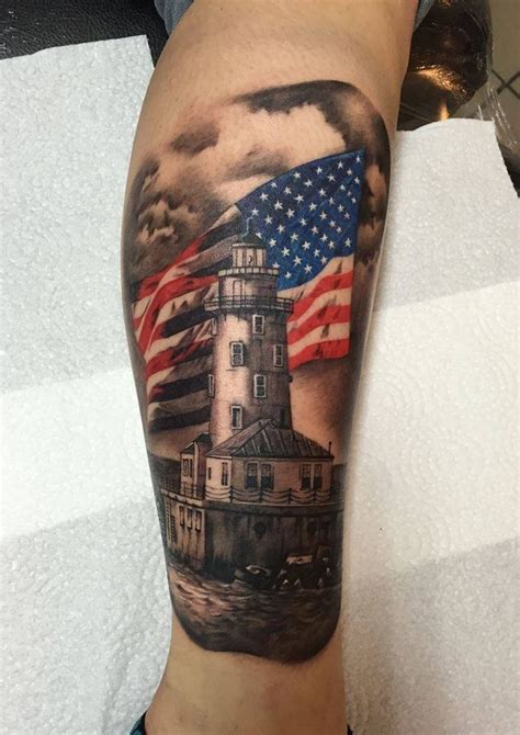 school style colored leg tattoo  big lighthouse