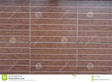 brown striped tiles   covering wall stock photo