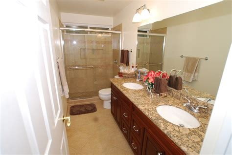 double sink vanity  porcelain tile shower recessed
