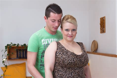 Big breasted housewife playing with her toy boy