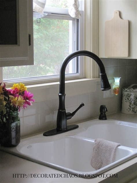 White Kitchen Sink With Stainless Steel Faucet by Decorated Chaos New Pfister Faucet In Tuscan Bronze And
