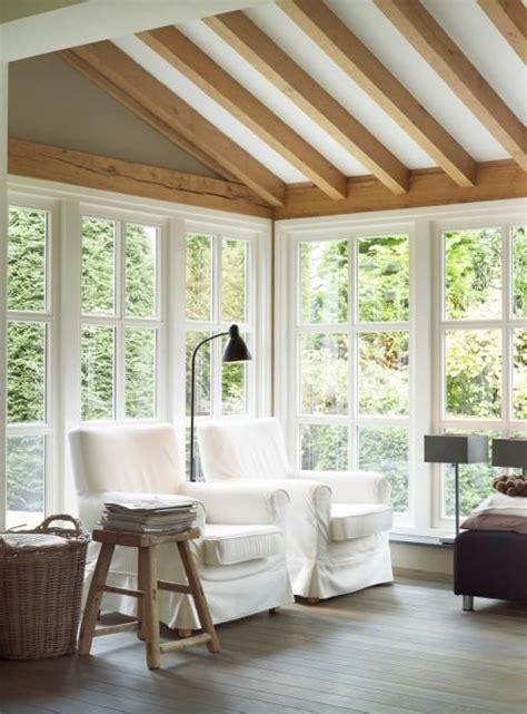 rustic modern sunroom sun porch  exposed beam
