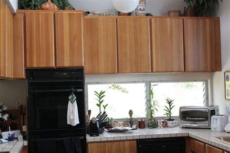 photo   refinishing solid oak kitchen cabinet yelp