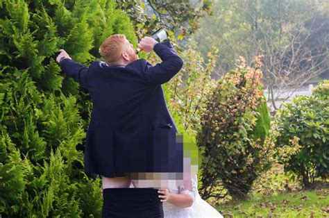 Couple Perform Oral Sex Act During Wedding Photoshoot