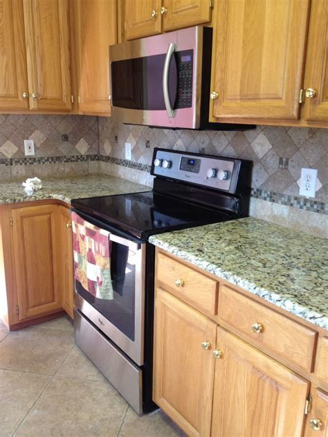 Venetian Ice granite with noce travertine backsplash