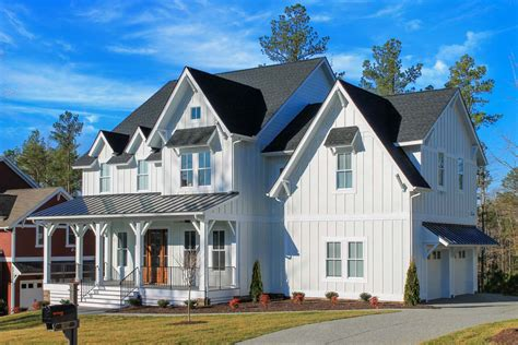 4 Bed Farmhouse Plan With Rocking Chair Porch 500003vv