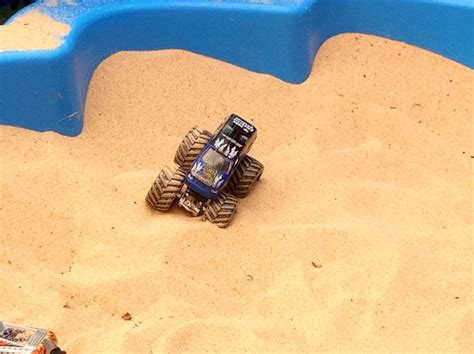 Boy Playing Sand Sandpit Toy Monster Truck Race