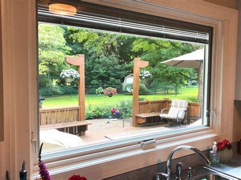 large awning window transforms backyard view pella cleveland