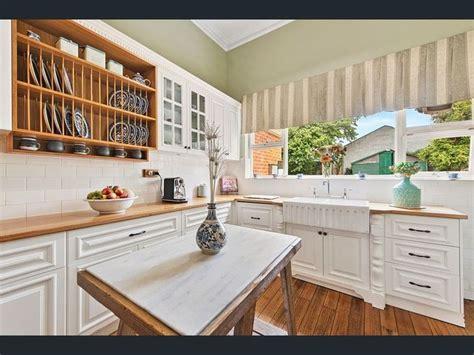traditional modern kitchen  fancy butler sink subway tiles sage green walls open plate