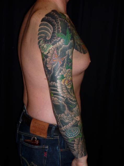 true nature tattoo clouds rocks  peonies sleeve
