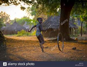 Anuak Child Girl Playing With A Wheel In Abobo, The Former ...