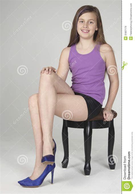 teen girl sitting  posing royalty  stock images