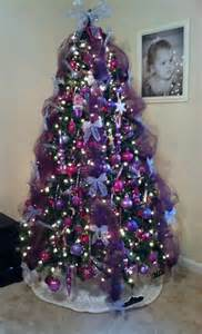 our christmas tree this year pink purple and silver tulle is a great decorating tool