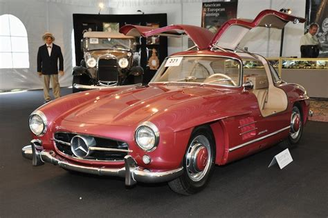 The car is finished in its factory color combination of graphite gray (code db190) over a light gray (db955) leather interior. 1955 Mercedes-Benz 300SL Gullwing - Sold for $546,000 versus pre-sale estimate of $500,000 ...