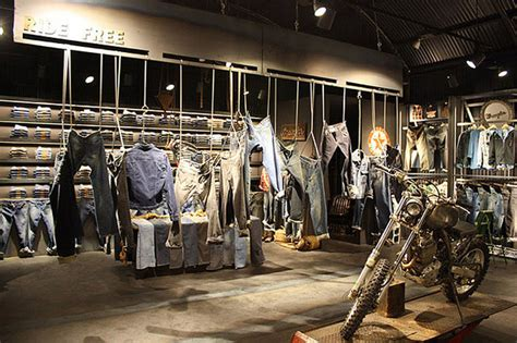 retail interior design wrangler stand at bread and butter by the wardrobe Industrial
