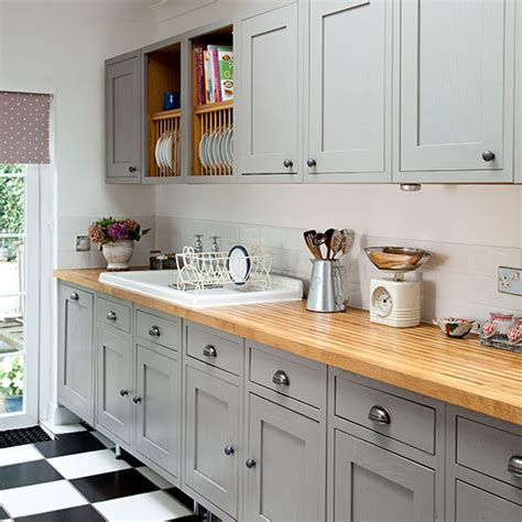 Grey Shaker style kitchen with wooden worktop   Decorating