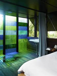 Cottage with Colored Glass Walls and Pre-existing Trees ...