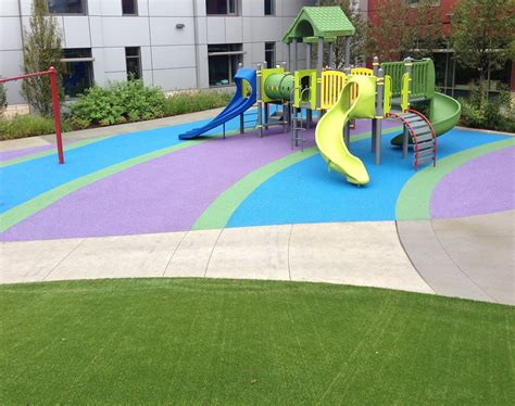 Poured Rubber Flooring For Playgrounds by Playbound Poured In Place Rubber Playground Surface