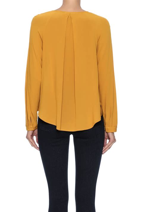 mustard blouse alythea mustard cross blouse from florida by momni