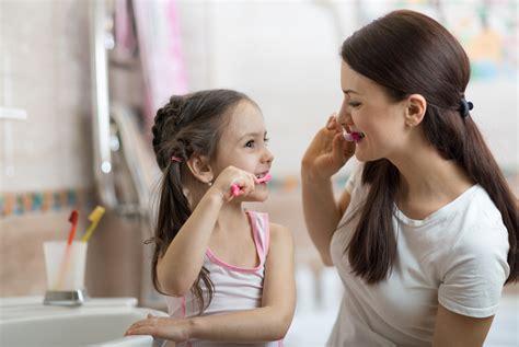 child girl  mom brushing teeth  bath growing
