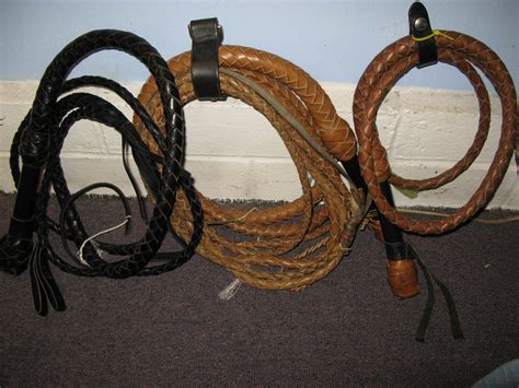 Cowhide Whip by Don T Underestimate The Value Of The Swivel Handled