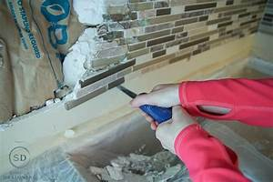 Kitchen remodel reveal how to install a kitchen cabinet for Remove tile backsplash on drywall