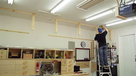how to build overhead garage storage rack wasted space garage storage shelves jays custom creations