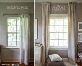 hang curtains up to the ceiling to make a low ceiling look
