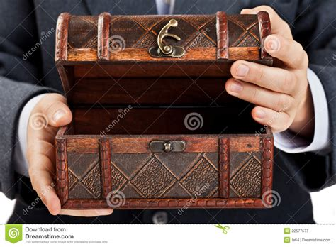 hand holding treasure chest royalty  stock photography