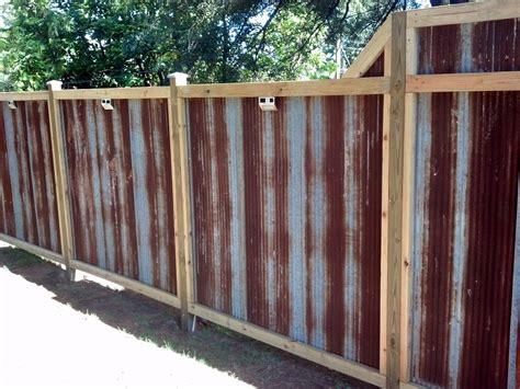 corrugated metal fence the rustic corrugated tin fence my husband and i built made from recycled corrugated tin bought