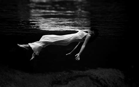 monochrome underwater floating women white dress