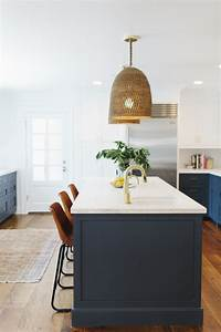 Gorgeous pendant lights over an island bench a house