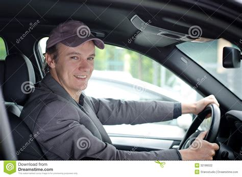 Handsome Young Man At Wheel Driving Car Stock Photo