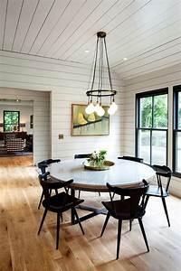 idyllic portland home blends industrial and mid century styles With modern round dining table a new family tradition