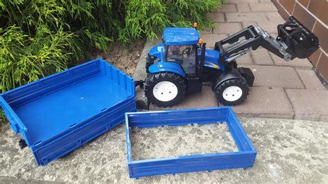 bruder traktor  holland   ladowaczem  przyczepa