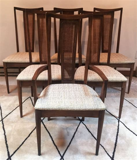 It's made with a slender metal frame, and has a seat and back covered in wicker rattan. Mid Century Modern Walnut Highback Dining Chairs, Rattan ...