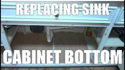 replacing  sink base cabinet bottom floor  water