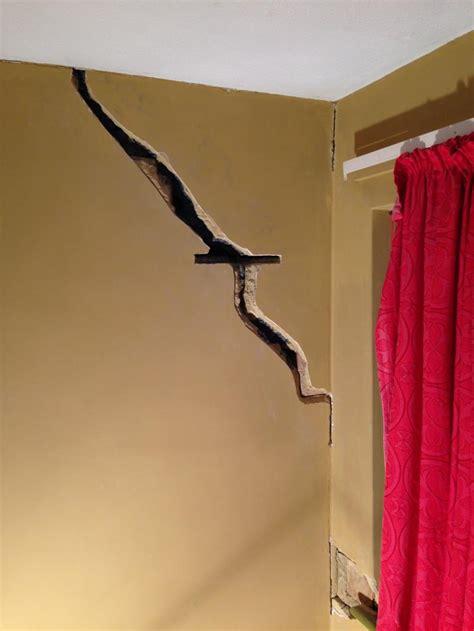 wall cracked  plaster  block advice needed