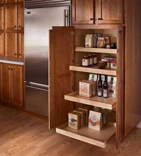 roll out trays for kitchen cabinets kraftmaid roll out trays the utility cabinet on the back 9252