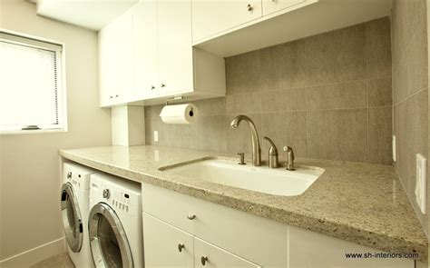 Ikea Small Kitchen Ideas - splashy under cabinet paper towel holder in laundry room modern with mudroom sink next to under